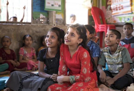 Mostakima Aktar, 11 and her best friend Shamima Aktar, 11, sit close to each other during a class in a UNICEF-supported learning centre in Camp 9 of Balukhali refugee camp in Cox's Bazar, Bangladesh